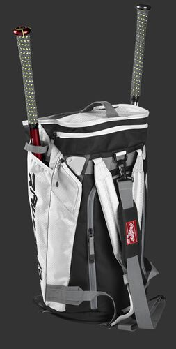 Right angle of a white R601 Hybrid players duffel bag standing up with two bats