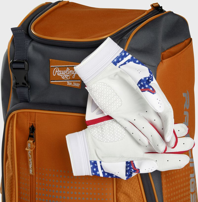Two batting gloves hanging on the front Velcro strap of a Franchise baseball backpack - SKU: FRANBP-O