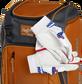 Two batting gloves hanging on the front Velcro strap of a Franchise baseball backpack - SKU: FRANBP-O image number null