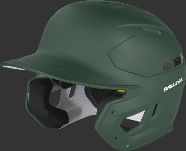 Left angle view of a CAR07A MACH Carbon high school college batting helmet with a dark green shell