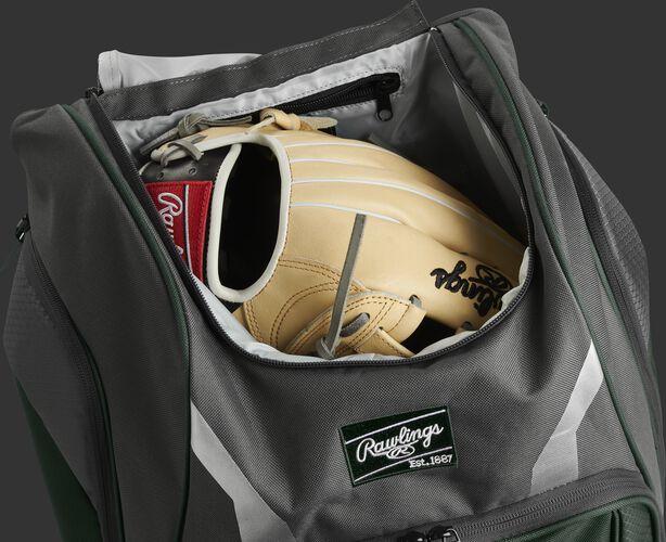 A glove in the dedicated glove storage pocket of a Rawlings Legion equipment backpack - SKU: LEGION-DG
