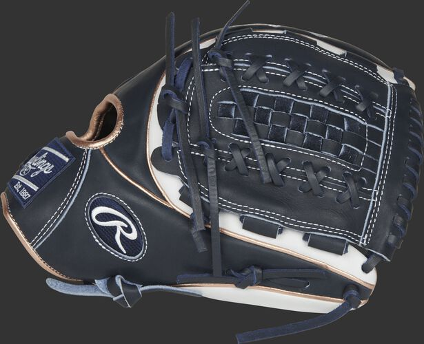 Thumb view of a navy/white Heart of the Hide 12-inch infield/pitcher's softball glove with a navy Double-Laced Basket Web