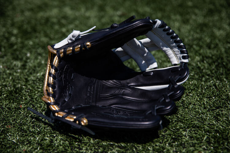 Black palm of an Encore 11.25-Inch infield glove lying on a field - SKU: EC1125-20BW