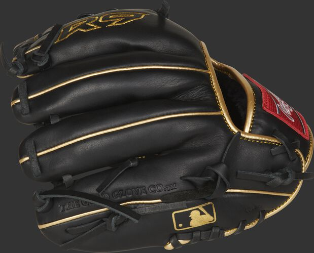 Black finger backs of a Rawlings R9 series training glove with gold welting and MLB logo on the pinkie - SKU: R9TRBG