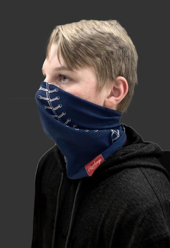 Side view of a kid wearing a navy youth multi-functional head and face gear cover with it covering his mouth/nose - SKU: YRC40001-400