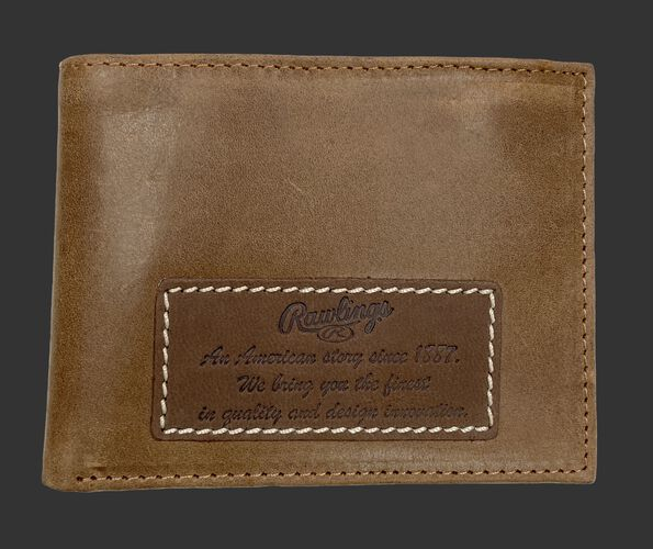 A tan American Story bi-fold wallet with a leather patch on it telling the Rawlings American story - SKU: RPW001-204