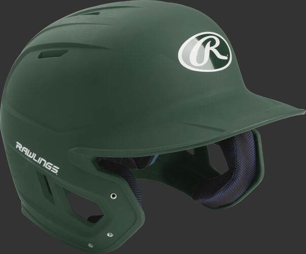 Right angle view of a matte MACH Senior batting helmet with a dark green shell