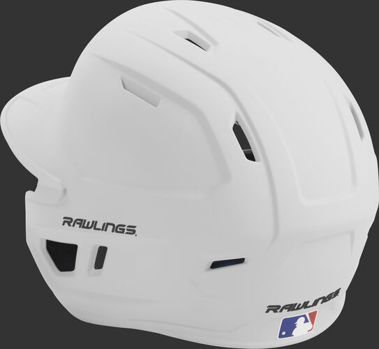 Back left view of a matte white MACH series batting helmet with air vents