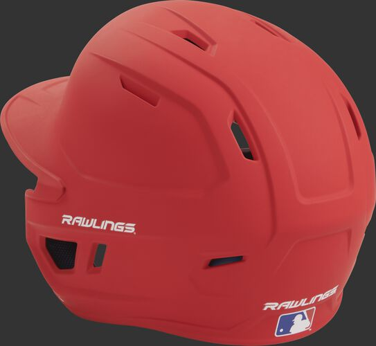 Back left view of a matte scarlet MACH series batting helmet with air vents
