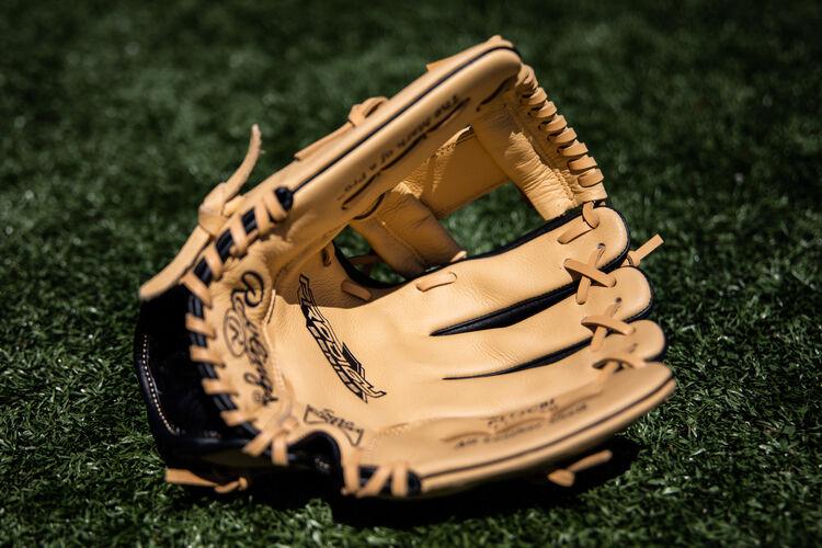 Camel palm of a Prodigy I-web infield glove lying on a field - SKU: P115CBI