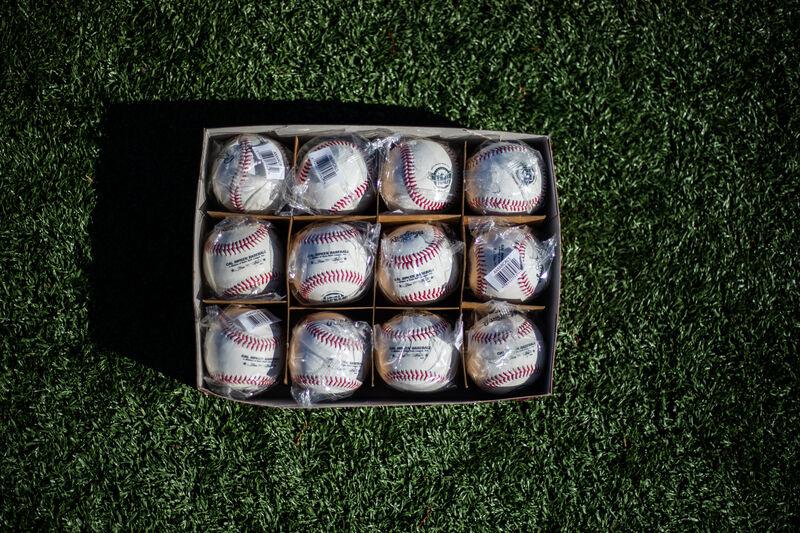 On open box of a dozen Rawlings Cal Ripken league baseballs - SKU: RCAL1