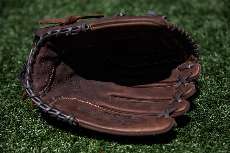 Brown palm of a Player Preferred softball glove lying on a field - SKU: P140BPS