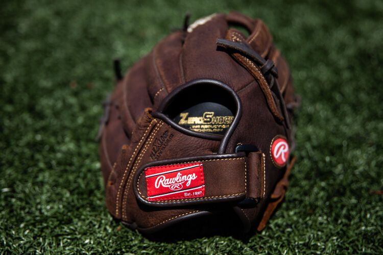 Rawlings patch on the wrist strap of a Player Preferred recreational glove on field - SKU: P130HFL