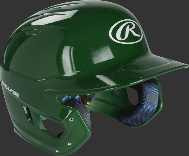 Right angle view of a MCC01 Rawlings Mach helmet with a gloss dark green shell
