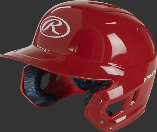 Left angle view of a scarlet MCH01A Mach high school/college batting helmet