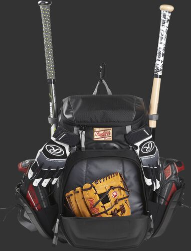 Front compartment of a black R1000 Rawlings Gold Glove Series backpack with a glove and batting gloves