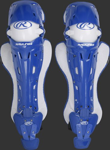 A pair of adult royal Rawlings Mach catcher's leg guards with white accents - SKU: MCHLGA-R
