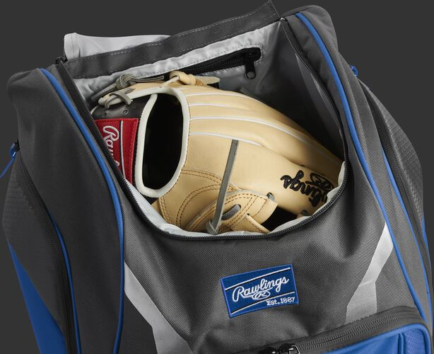 A glove in the dedicated glove storage pocket of a Rawlings Legion equipment backpack - SKU: LEGION-R