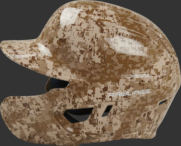 Left side of a MACHEXTR-DCMO Rawlings Mach EXT batting helmet with an MEXT face guard extension attached