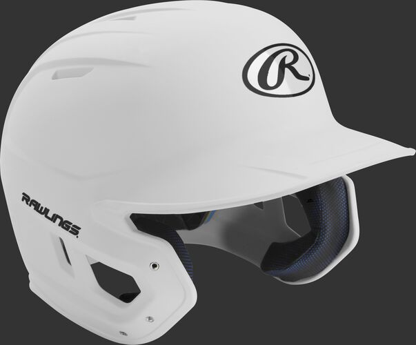 Right angle view of a matte MACH Senior batting helmet with a white shell