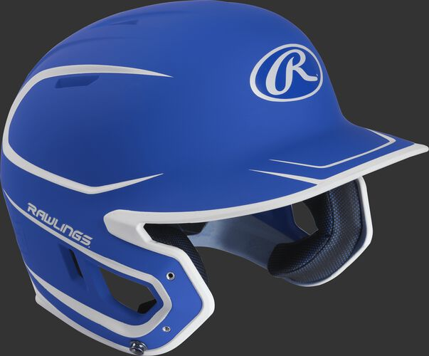 Right angle view of a matte MACH Senior batting helmet with a royal/white shell