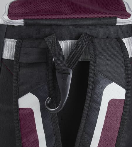 Exterior handle on the back of a black/maroon R500 backpack with a hook for hanging it up