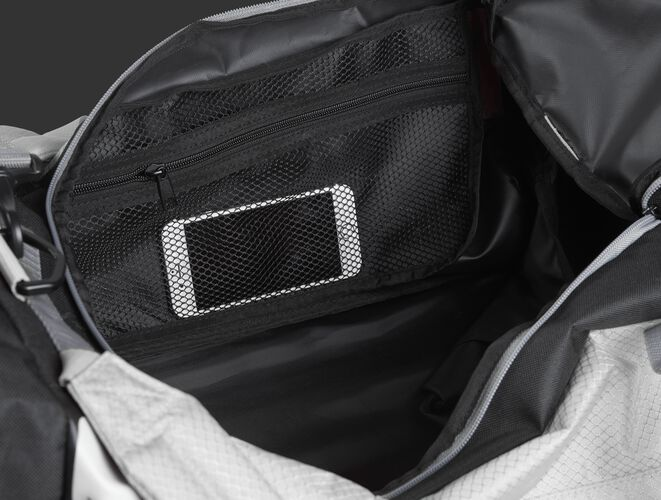 A phone inside the mesh accessory pocket inside the main compartment of a white R601 Hybrid bag