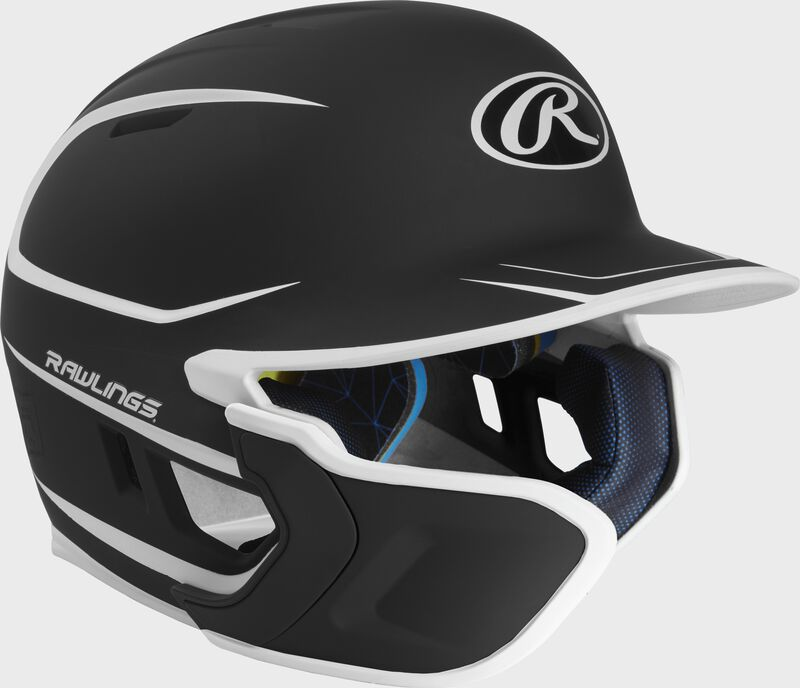 Right angle view of a matte black/white MACHEXTR Mach Junior helmet with Mach EXT left hand batter face guard extension