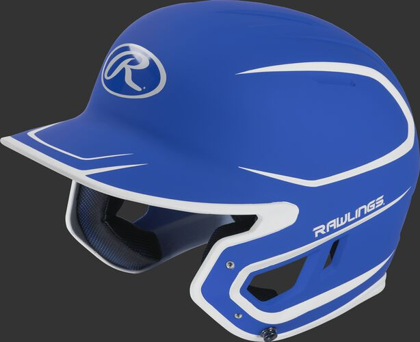 Left angle view of a Rawlings MACH Senior helmet with a two-tone matte royal/white shell