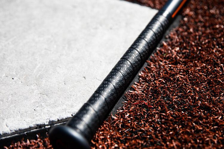 Batting grip of a 2020 Impact baseball bat next to home plate - SKU: BBZI3