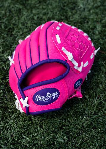 Purple Rawlings logo on a pink Rawlings Players Series glove lying on a field - SKU: PL91PP