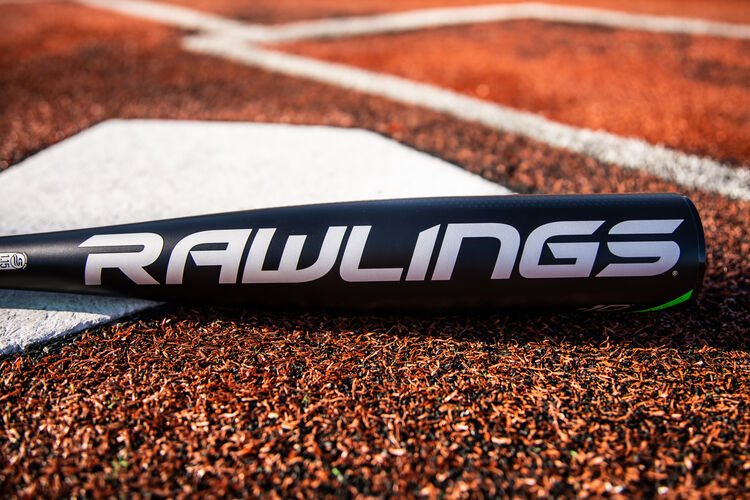 Rawlings logo on the barrel of a 2021 USSSA 5150 baseball bat laying on a field next to home plate - SKU: UT1510