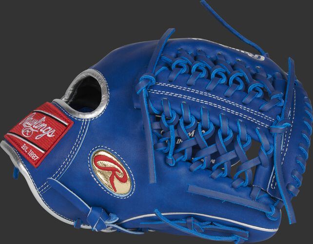 Thumb of a royal Gameday 57 Series Marcus Stroman Heart of the Hide glove with a gold Oval-R logo on the thumb - SKU: PRO205-MS0