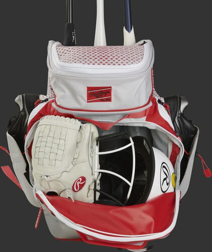 A filled white/scarlet R800 Rawlings softball backpack with a fastpitch glove and helmet in the main compartment