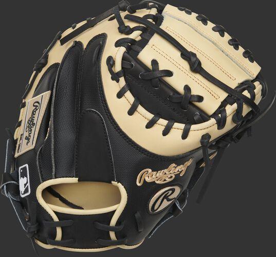 Black back of a 2020 Yadier Molina pattern HOH catcher's mitt with a black Rawlings patch - SKU: PROYM4BC