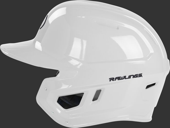 Left side of a white MCH01A Mach baseball helmet compatible with MEXT face guard extension