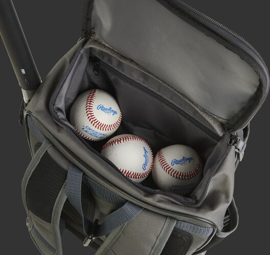 Three baseballs in the top valet tray of a grey R701 training bag