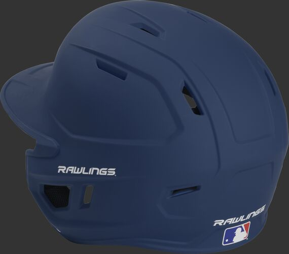 Back left view of a matte navy MACHEXTL MACH series batting helmet with air vents