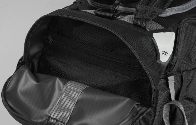 Side pocket of a black R601 hybrid backpack/duffel bag with a mesh compartment