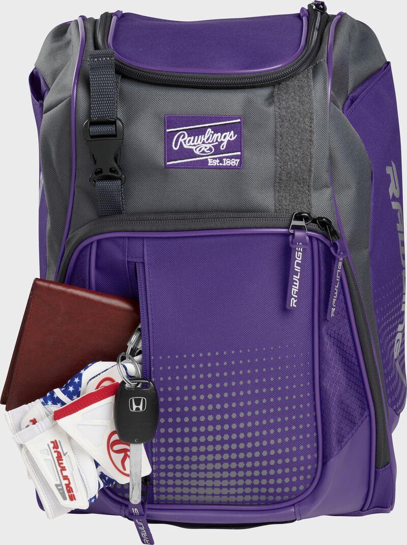 Wallet, keys, and batting gloves in the front valuables pocket of a purple Franchise baseball bag - SKU: FRANBP-PU
