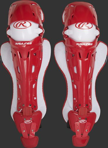 A pair of adult scarlet Rawlings Mach catcher's leg guards with white accents - SKU: MCHLGA-S