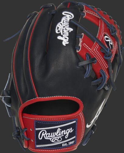 Back of a navy/scarlet Atlanta Braves Heart of the Hide I-web glove with a navy Rawlings patch - SKU: RSGPRO204-2ATL
