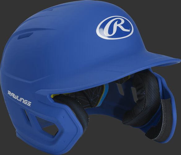 Right angle view of a MACHEXTR Rawlings Mach EXT junior helmet with a one-tone matte royal shell