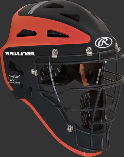 Front right of a black/orange CHVEL Rawlings Velo adult catcher's helmet
