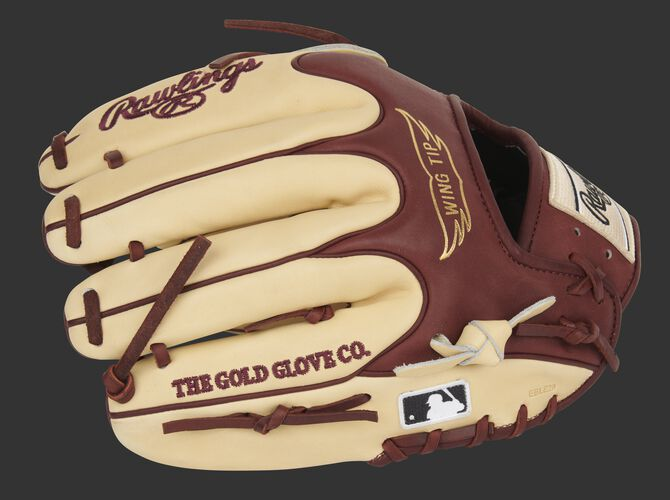 Camel finger backs of a Heart of the Hide Wing Tip infield/pitcher's glove with the MLB logo on the pinkie - SKU: PRO205-9CSH