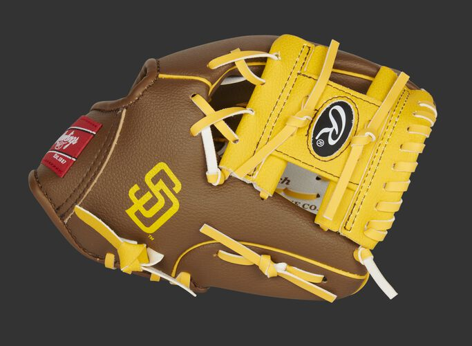 Thumb of a brown/white San Diego Padres 10-Inch team logo glove with a tan I-web and SD logo on the thumb - SKU: 22000019111