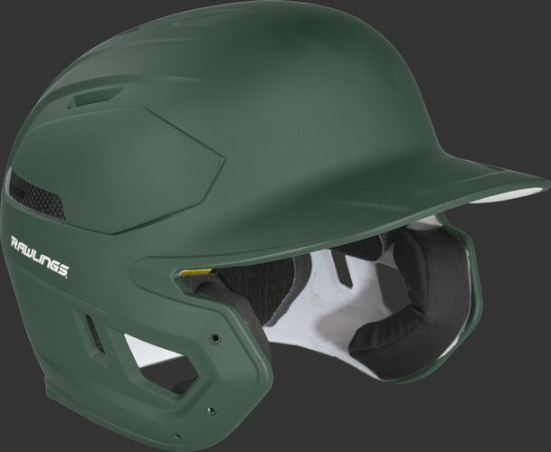 Right angle view of a dark green CAR07A Rawlings MACH Carbon batting helmet