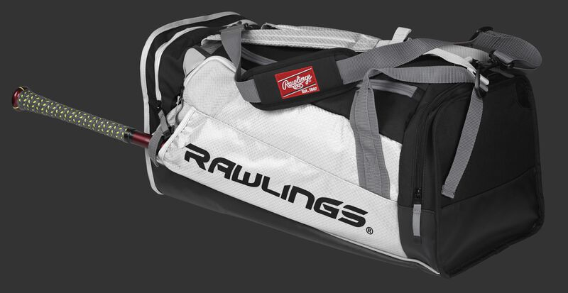 Side angle view of a white R601 Hybrid players duffel bag with a bat in the side sleeve