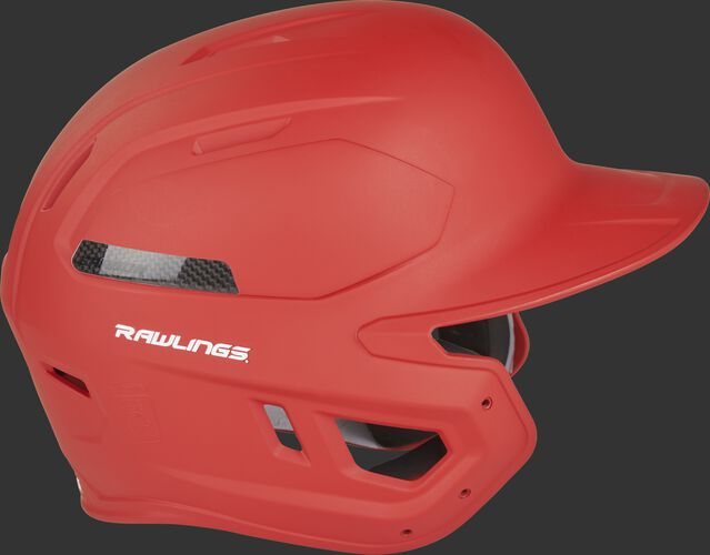 Right side of a CAR07A adult Rawlings batting helmet with a scarlet shell and carbon fiber plate insert