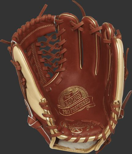PROS204-4BR 11.5-inch Rawlings infield/pitcher's glove with a buciato palm and dark tan laces